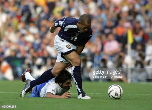 Italy's Gennaro Gattuso slides under the foot of Scotland's Nigel Quashie during the World Cup qualifier at Hampden Park Glasgow Saturday September 3...