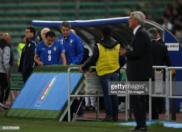 Italy's Giampaolo Pazzini heads for the dressing after being sent off during the World Cup Qualifying match at the Stadio San Nicola Bari Italy