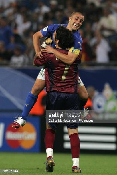 Italy's Gianluigi Buffon and Fabio Cannavaro celebrate at the end of the match