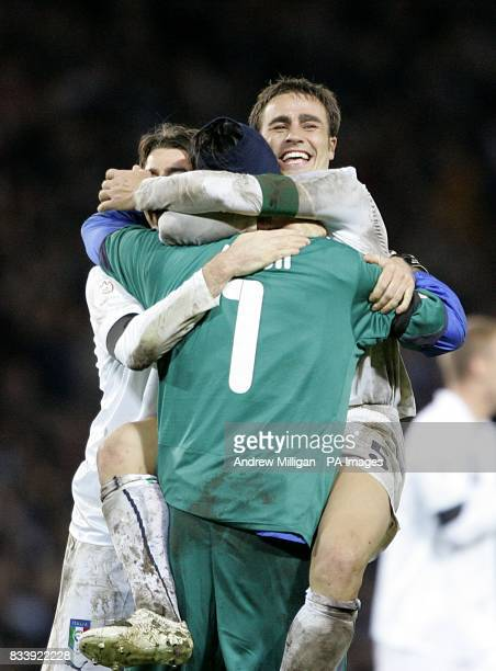 Italy's Gianluigi Buffon and Fabio Cannavaro celebrate victory after the final whistle