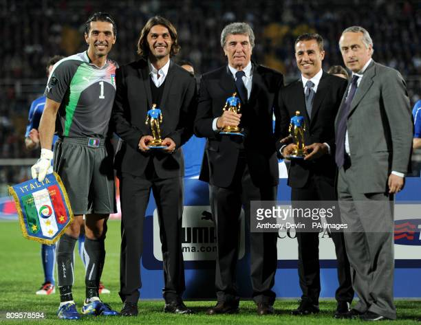 Italy's Gianluigi Buffon Paulo Maldini Dino Zoff and Fabio Cannavaro receive an award for earning 100 or more international caps