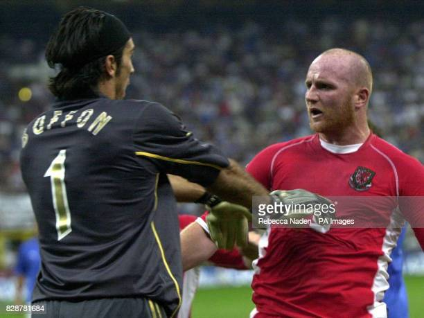Italy's Gianluigi Buffon pushes away Wales' John Hartson during their group nine Euro 2004 qualifying match at San Siro Milan Italy