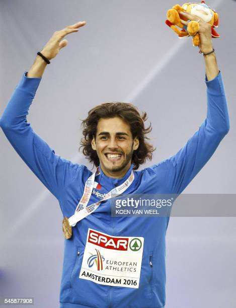 OUT*** Italy's Gianmarco Tamberi reacts during the medal ceremony for the men's Pole Vault at the European Athletics Championships at the Olympic...