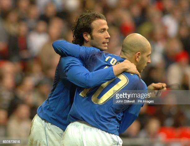 Italy's Gianpaolo Pazzini celebrates scoring his sides second goal of the game with teammate Alessandro Rosina