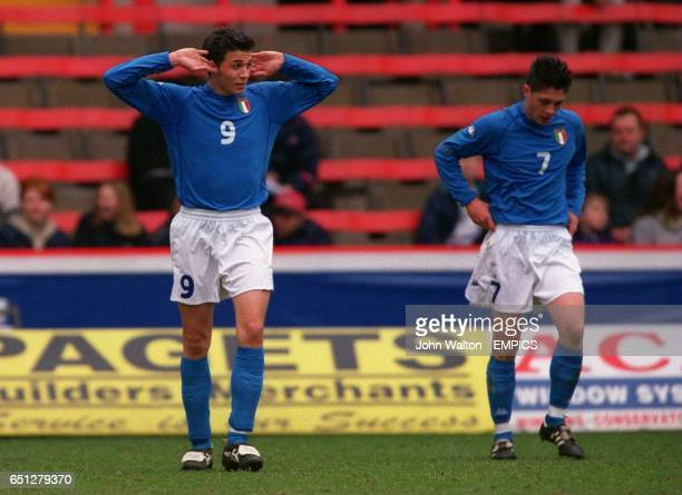 LR Italy's Gianpaolo Pazzini listen's to the crowd's reaction after their equalising goal
