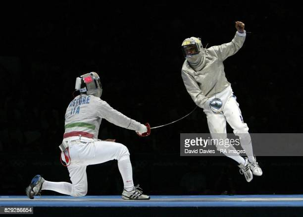 Italy's Gianpiero Pastore and France's Damien Touya in action during the Men's Team Sabre Fencing Gold Medal match at the Helliniko Fencing Hall in...