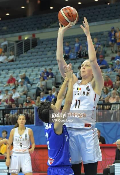 Italy's Giorgia Sottana blocks Belgium's Emma Meesseman during the FIBA EuroBasket 2017 women's quarterfinal match between Belgium and Italy on June...