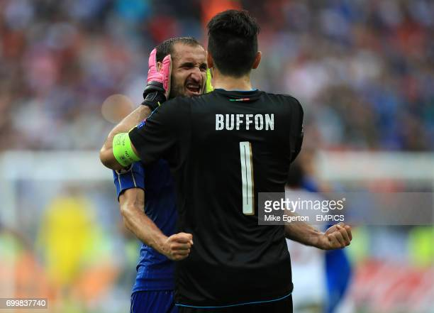 Italy's Giorgio Chiellini and goalkeeper Gianluigi Buffon celebrate after the final whistle
