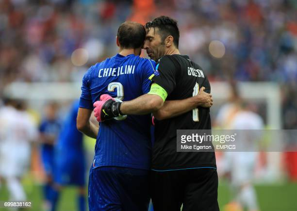 Italy's Giorgio Chiellini and Italy goalkeeper Gianluigi Buffon celebrate after the final whistle