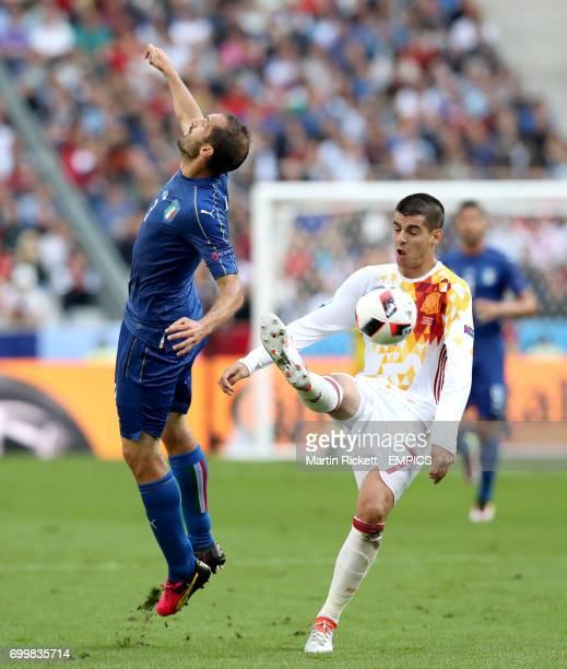 Italy's Giorgio Chiellini and Spain's Alvaro Morata battle for the ball