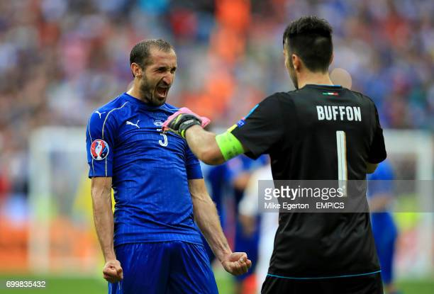 Italy's Giorgio Chiellini celeabrates with goalkeeper Gianluigi Buffon after the final whistle
