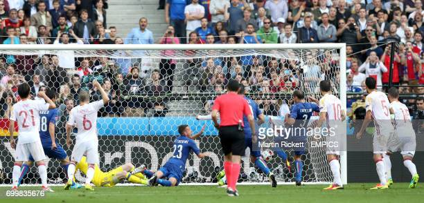 Italy's Giorgio Chiellini scores his side's first goal of the game