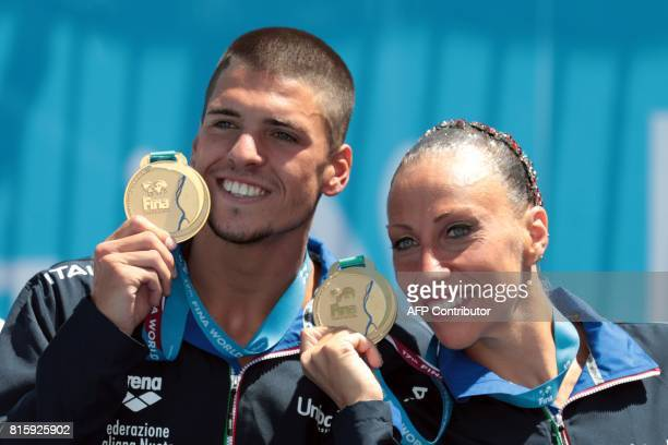 Italy's Giorgio Minisini and Italy's Manila Flamini pose with their gold medal during the podium ceremony for the Mixed Duet technical final during...