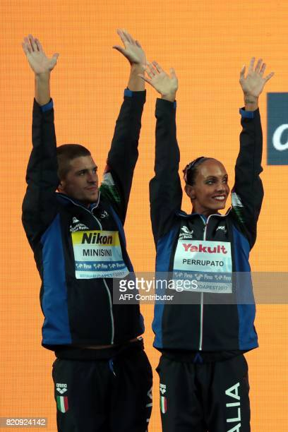 Italy's Giorgio Minisini and Italy's Mariangela Perrupato celebrate winning the silver medal during the podium ceremony for the Mixed duet Free...