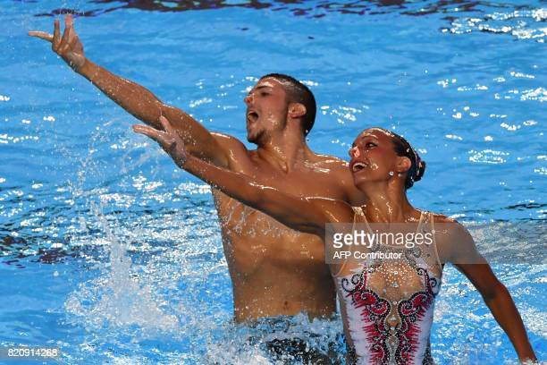 Italy's Giorgio Minisini and Italy's Mariangela Perrupato compete in the Mixed duet Free Routine preliminary during the synchronised swimming...