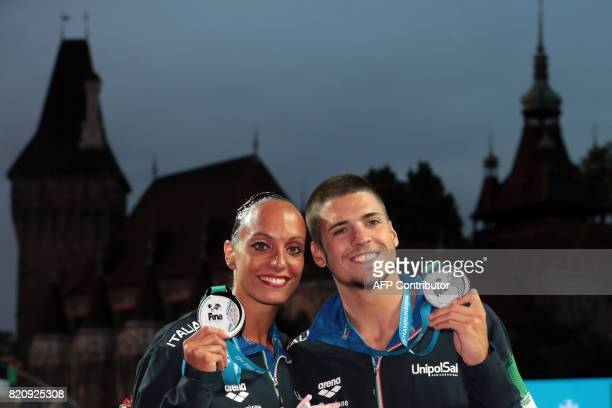 Italy's Giorgio Minisini and Italy's Mariangela Perrupato pose with their silver medal during the podium ceremony for the Mixed duet Free Routine...