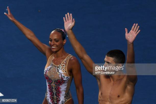 Italy's Giorgio Minisini and Italy's Mariangela Perrupato react after competing in the Mixed duet Free Routine preliminary during the synchronised...