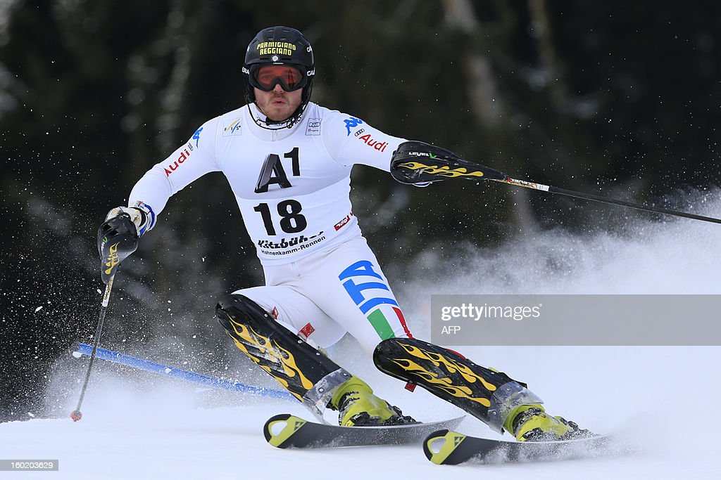 Italy's Giuliano Razzoli competes during the first round of the FIS World Cup men's slalom race on January 27, 2013 in Kitzbuehel, Austrian Alps. AFP PHOTO / ALEXANDER KLEIN