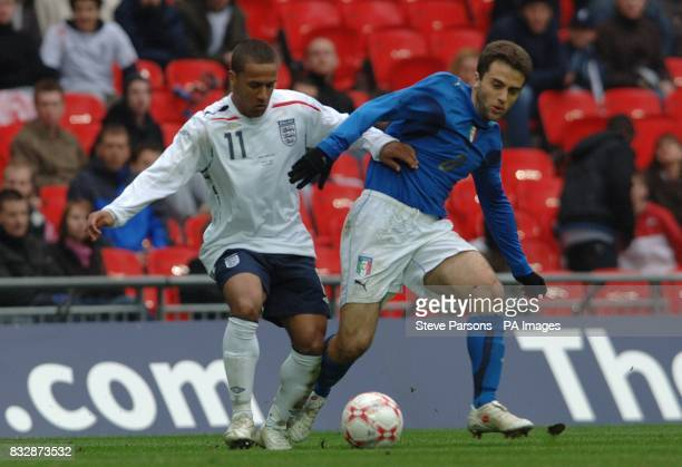italy's Giuseppe Rossi and England's Wayne Routledge battle for the ball