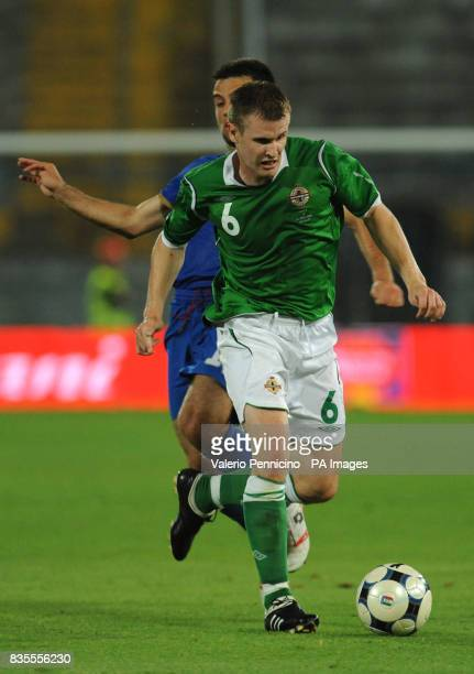 Italy's Giuseppe Rossi and Northern Ireland's Michael O'Connor in action during the International Friendly at the Arena Garibaldi Stadium Pisa Italy