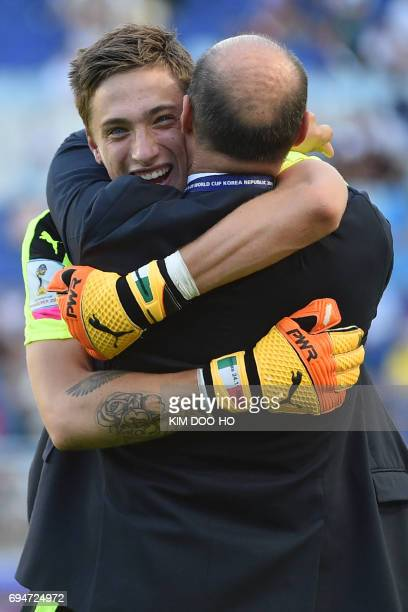 Italy's goalkeeper Alessandro Plizzari celebrates their victory after a penalty shootout during the U20 World Cup third place playoff football match...