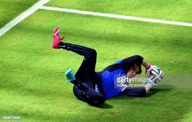 Italy's goalkeeper and captain Gianluigi Buffon takes part in a training session at the Pernambuco Arena in Recife on June 19 2014 on the eve of...