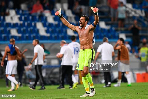 Italy's goalkeeper and captain Gianluigi Buffon waves to supporters at the end of the FIFA World Cup 2018 qualification football match between Italy...