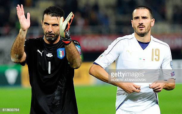 Italy's goalkeeper Gianluigi Buffon and Italy's defender Leonardo Bonucci react as they celebrate after winning the FIFA World Cup 2018 qualifying...