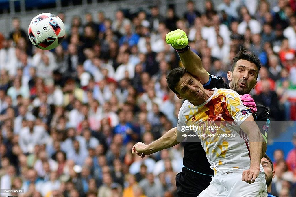 Italy's goalkeeper Gianluigi Buffon (R) blocks the ball next to Spain's forward Aritz Aduriz during the Euro 2016 round of 16 football match between Italy and Spain at the Stade de France stadium in Saint-Denis, near Paris, on June 27, 2016. / AFP / PIERRE