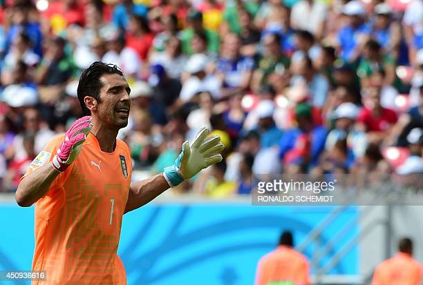 Italy's goalkeeper Gianluigi Buffon gestures during a Group D football match between Italy and Costa Rica at the Pernambuco Arena in Recife during...