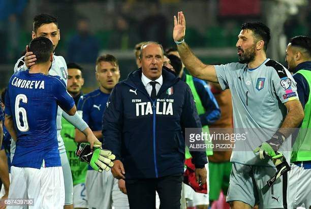 Italy's goalkeeper Gianluigi Buffon greets fans next to Italy's coach Giampiero Ventura at the end of the FIFA World Cup 2018 qualification football...