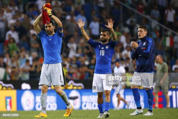 Italy's goalkeeper Gianluigi Buffon Italy's forward Lorenzo Insigne and Italy's forward Andrea Belotti wave at the end of the FIFA World Cup 2018...