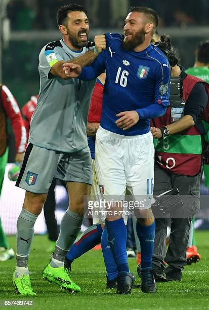 Italy's goalkeeper Gianluigi Buffon jokes with Italy's midfielder Daniele De Rossi at the end of the FIFA World Cup 2018 qualification football match...