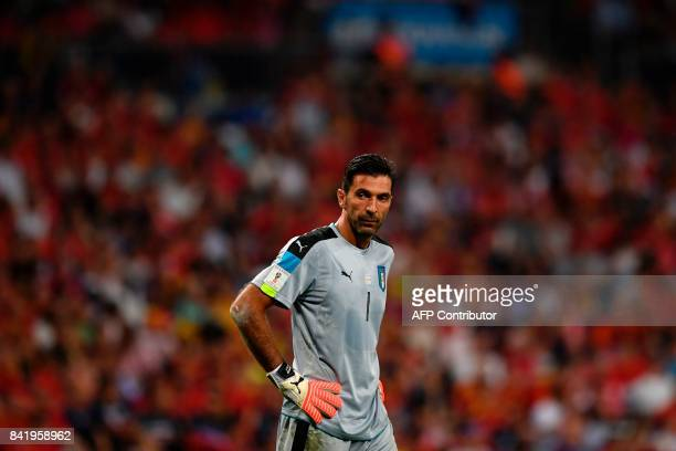 Italy's goalkeeper Gianluigi Buffon looks on during the World Cup 2018 qualifier football match Spain vs Italy at the Santiago Bernabeu stadium in...