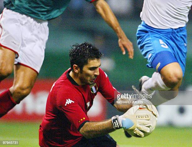 Italy's goalkeeper Gianluigi Buffon makes a save during second half action of match 43 group G of the 2002 FIFA World Cup Korea Japan 13 June 2002 in...