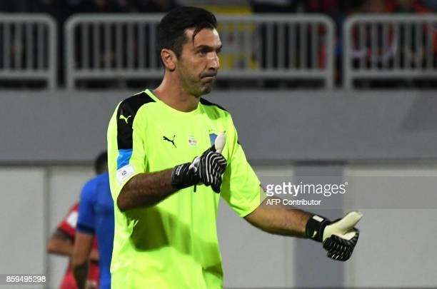 Italy's goalkeeper Gianluigi Buffon reacts during the FIFA World Cup 2018 qualification football match between Albania and Italy at Loro during the...