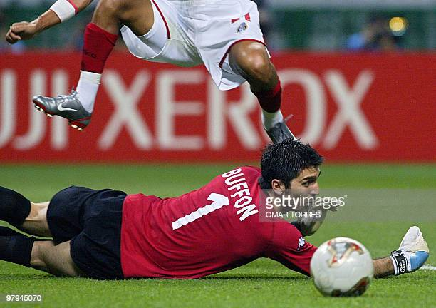 Italy's goalkeeper Gianluigi Buffon watches the ball after a save during match 43 group G of the 2002 FIFA World Cup Korea Japan opposing Mexico and...