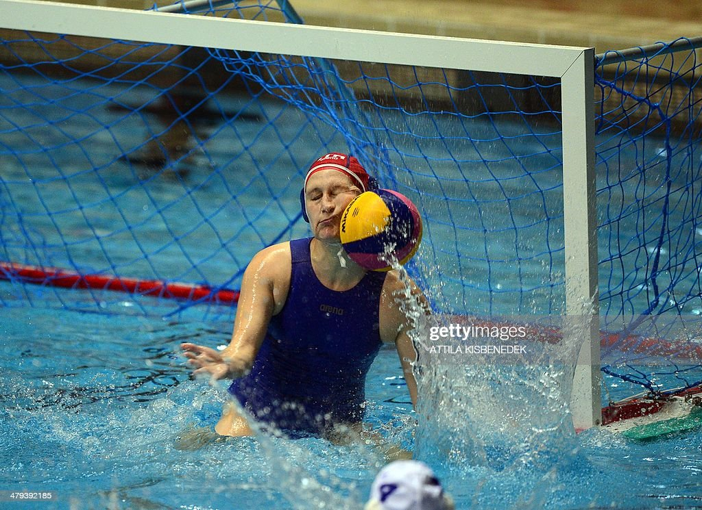 Italy's goalkeeper Giulia Gorlero saves the ball by her face against Hungary in the local swimming pool of Budapest on March 18, 2014 during a World League match between their teams. AFP PHOTO / ATTILA KISBENEDEK