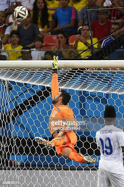 Italy's goalkeeper Salvatore Sirigu saves the ball during a Group D football match between England and Italy at the Amazonia Arena in Manaus during...