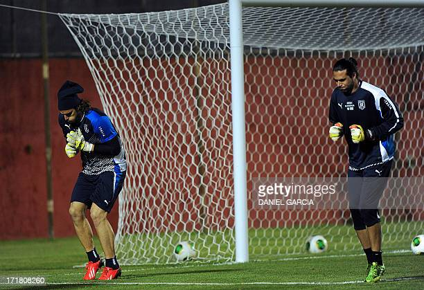 Italy's goalkeepers Salvatore Sirigu and Federico Marchetti make an exercise during a training session at the Roberto Santos stadium in Salvador on...