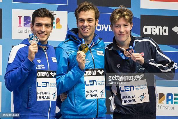 Italy's gold medalist Gregorio Paltrinieri his compatriot silver medalist Gabriele Detti and Norwegians bronze medalist Henrik Christiansen pose on...
