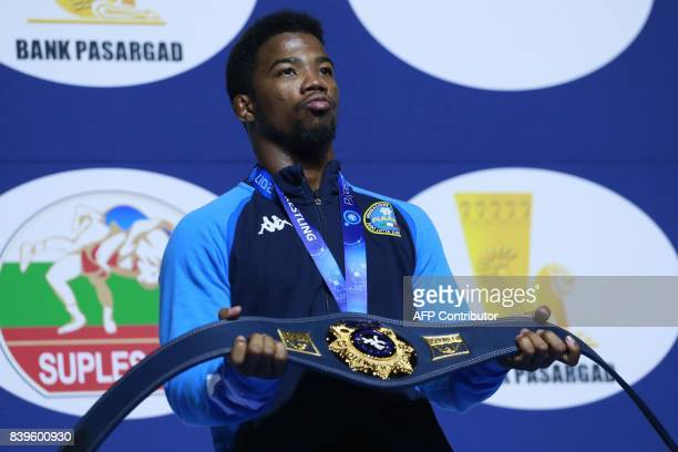 Italy's gold medallist Frank Chamizo celebrates on the podium during the medal ceremony for the men's freestyle wrestling 70kg category at the FILA...