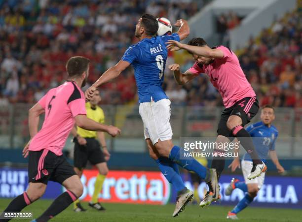 Italy's Graziano Pelle fights for the ball with Scotland's Russell Martin during the International friendly football match Italy vs Scotland at the...