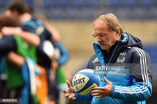 Italy's head coach Jacques Brunel plays with a ball during the captain's run of his team on February 6 2015 at the Olympic Stadium in Rome on the eve...