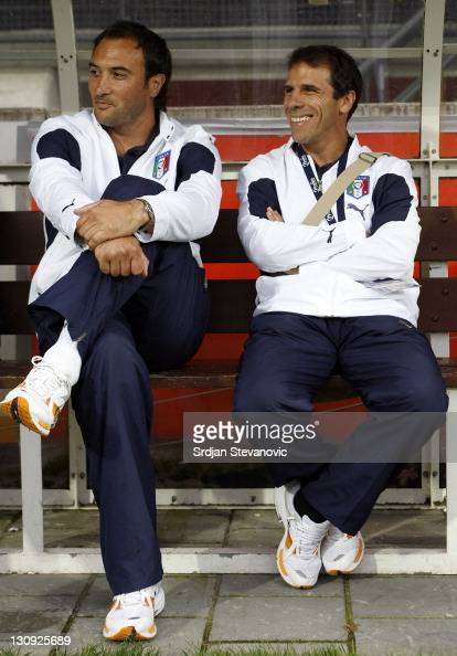 Italy's head coach Pierluigi Casiraghi left talk with Gianni Franco Zola right during their Olympic 2008 qualifying soccer match at the Goffert...
