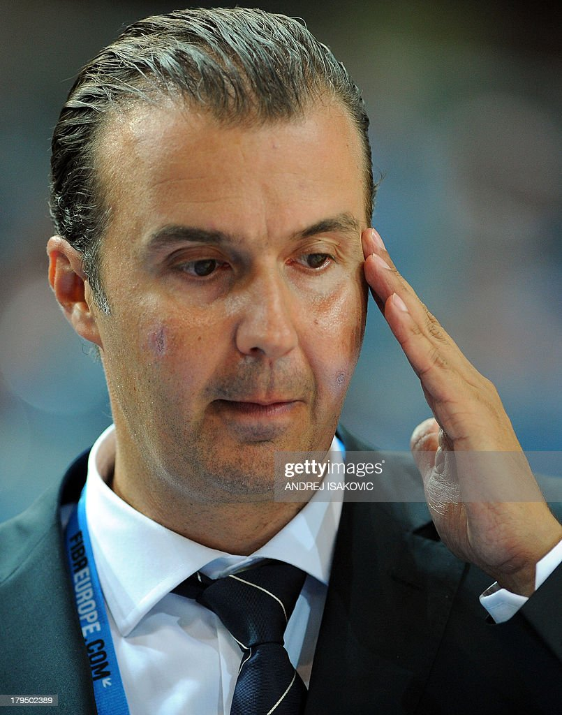 Italy's head coach Simone Pianigiani reacts reacts during the FIBA Eurobasket 2013 Group D qualification match Russia vs Italy in Koper on September 4, 2013. AFP PHOTO / ANDREJ ISAKOVIC