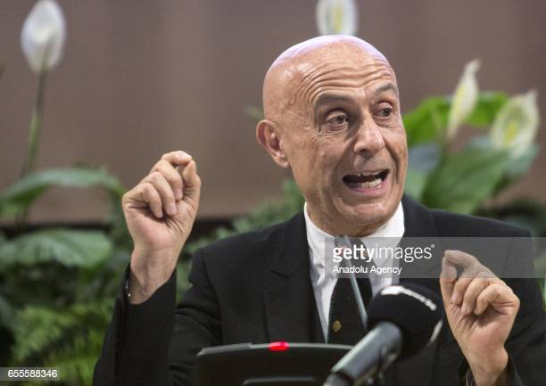 Italy's Interior Minister Marco Minniti delivers a speech during a joint press conference with EU Commissioner for Migration Home Affairs and...