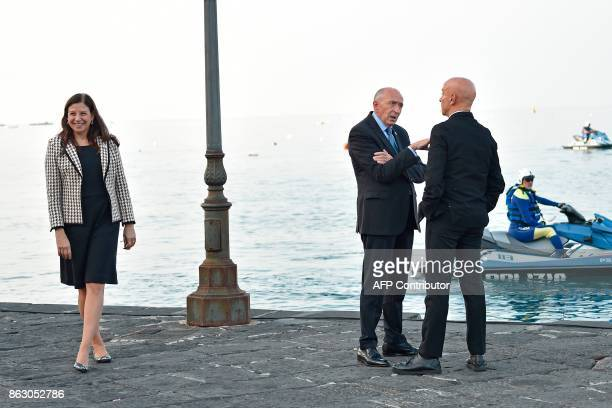 Italy's Interior Minister Marco Minniti speaks with France's Interior Minister Gerard Collomb next to US Acting Secretary of the Department of...