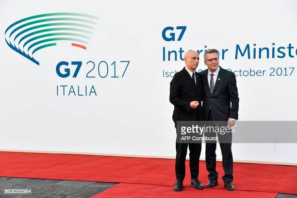Italy's Interior Minister Marco Minniti welcomes Germany's Interior Minister Thomas de Maizière on October 19 2017 near the Aragonese Castle of...