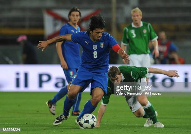 Italy's Ivan Gennaro Gattuso and Northern Ireland's Grant McCann in action during the International Friendly at the Arena Garibaldi Stadium Pisa Italy